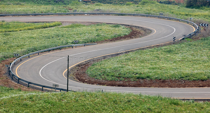 The Winding Road. A long winding road pictured stock photo