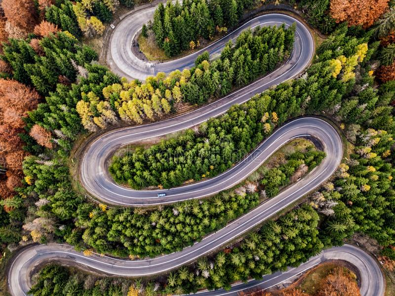 Winding road in autumn season. Winding road from high mountain pass, in autumn season. Romania royalty free stock images
