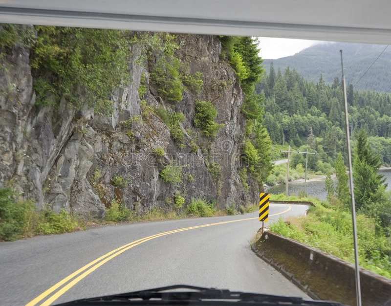 Winding Road Through Car Windshield Royalty Free Stock Images