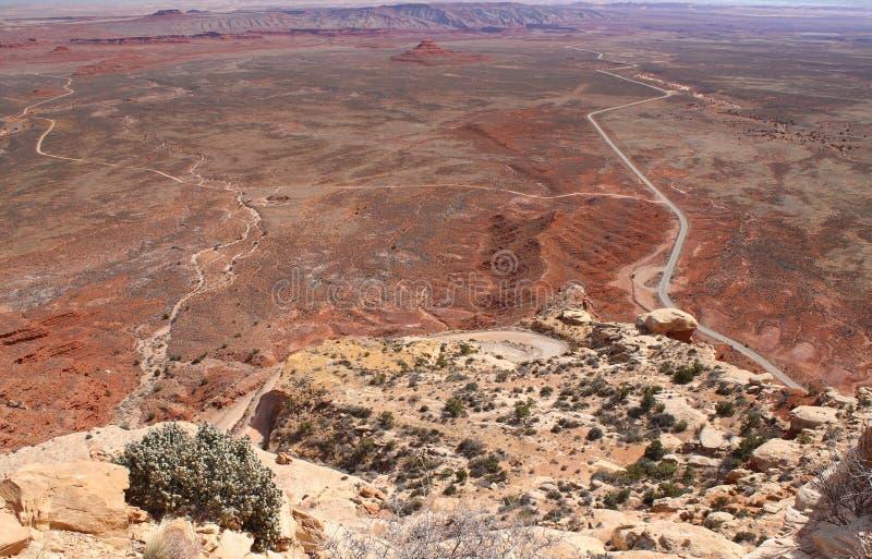 Winding road in the desert of Southwest Utah. A winding road across the desert of Southwest Utah going towards Natural Bridges National Monument stock image