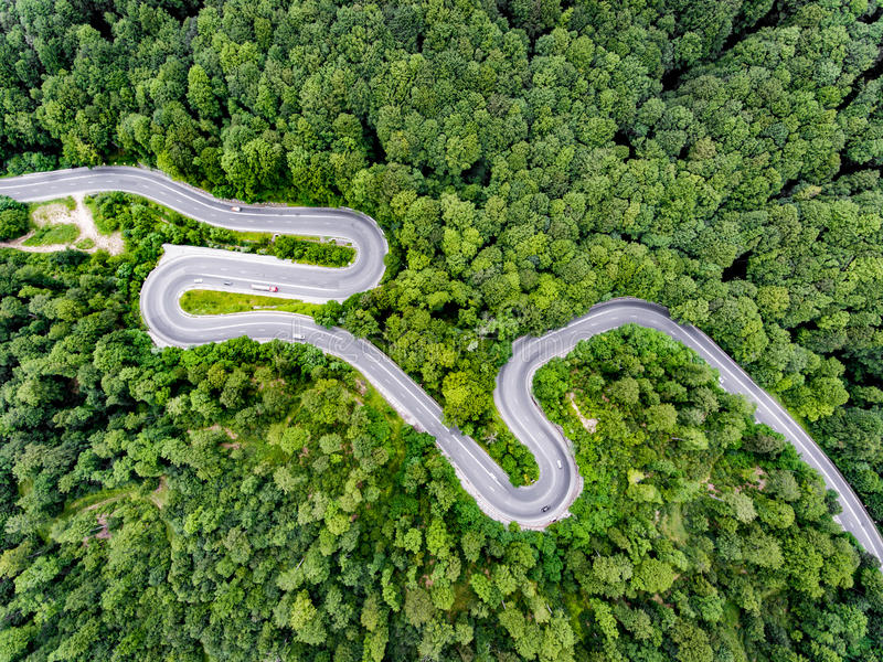 Download Winding Road In The Forest Aerial View Shot With A Drone Stock Image