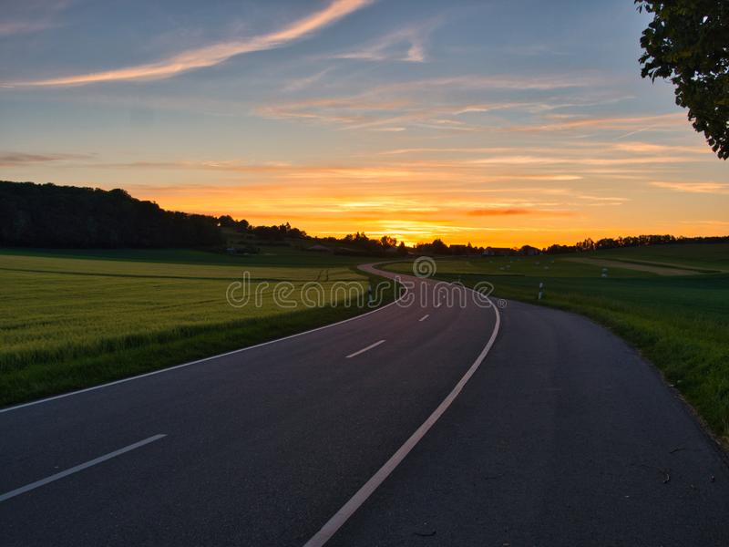 Winding road during golden hour royalty free stock image
