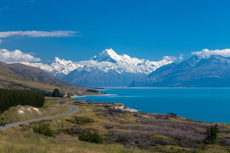 The Winding Road to Mount Cook. Winding road beside a lake on the way to Mount Cook in New Zealand stock image