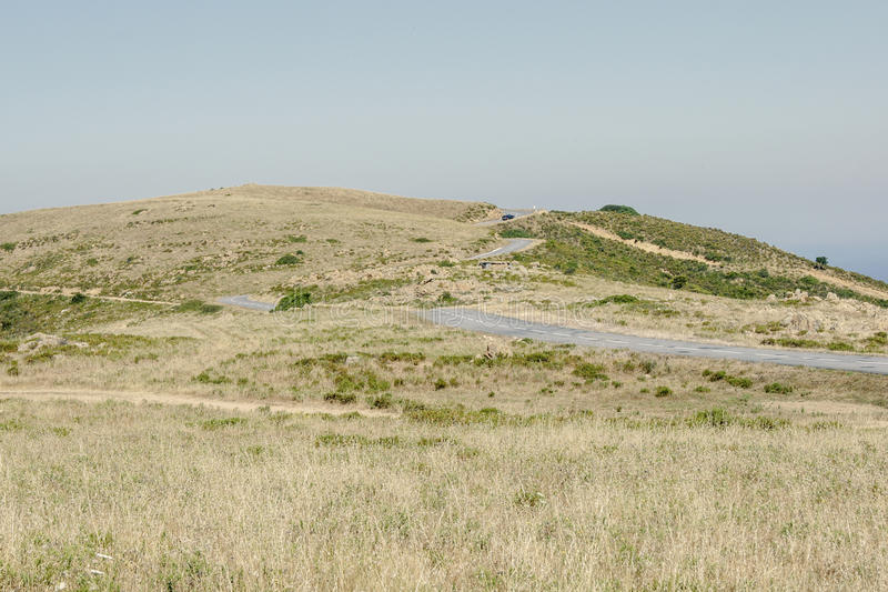 Winding Road. An winding road leading up de hill to the horizon royalty free stock image