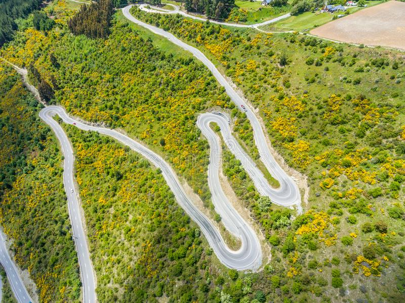 Winding road on mountain, Queenstown, New Zealand royalty free stock photos