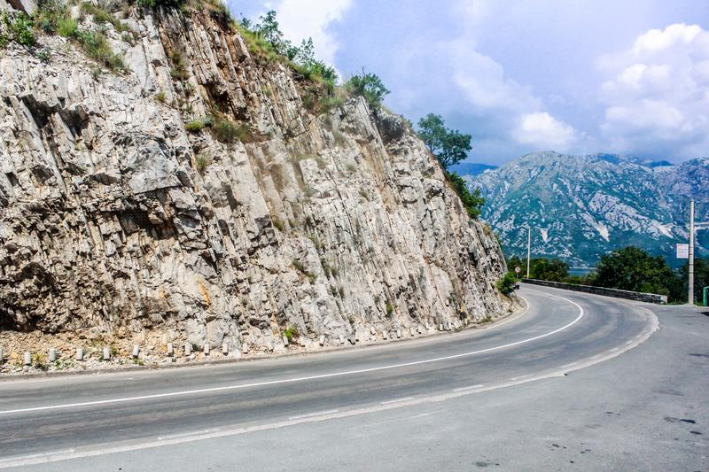 A winding road with rain clouds stock photography
