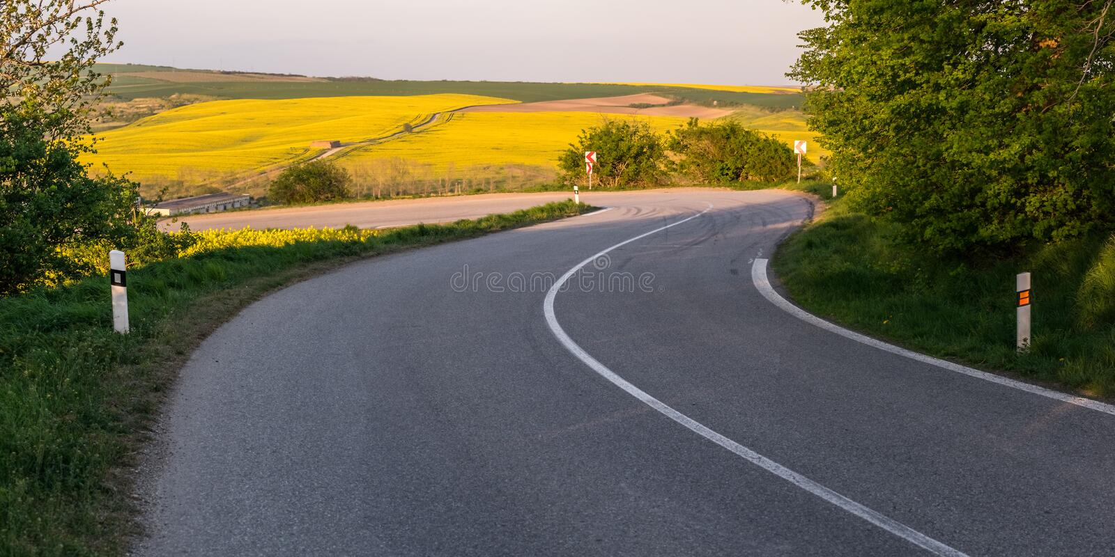 A winding road. With tire tracks on the asphalt, a sharp turn royalty free stock image
