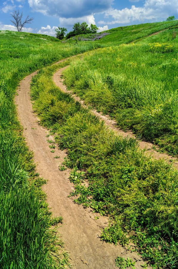 Winding road to the clouds royalty free stock photos