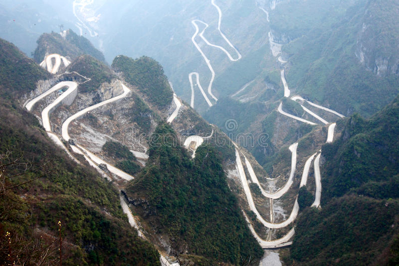 Winding roads in mountains stock photos