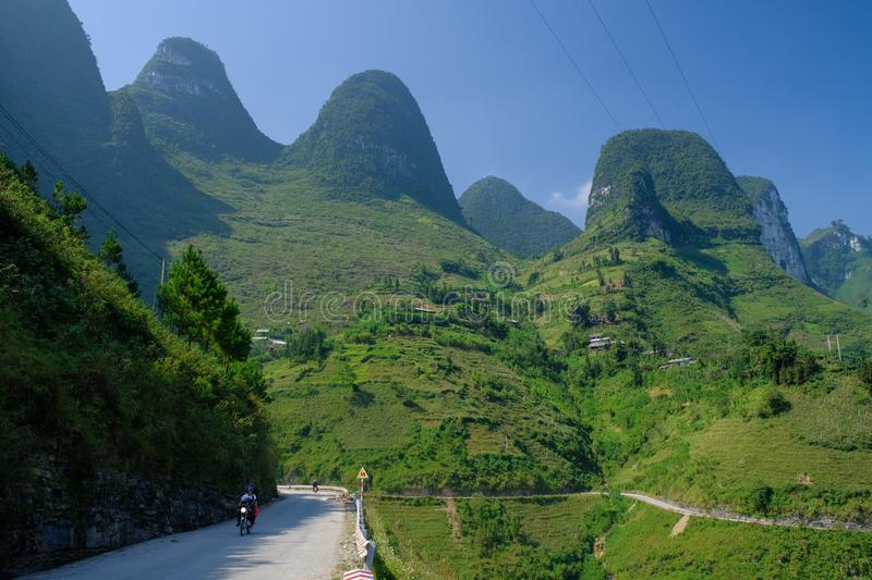 Winding roads through valleys and karst mountain scenery in the North Vietnamese region of Ha Giang / Van royalty free stock photo
