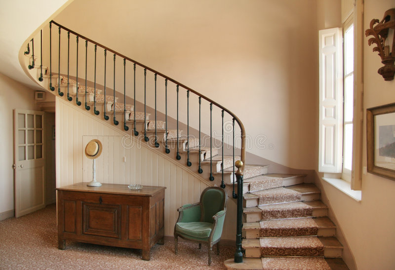 Winding Staircase. Historic staircase in French Chateau stock photos