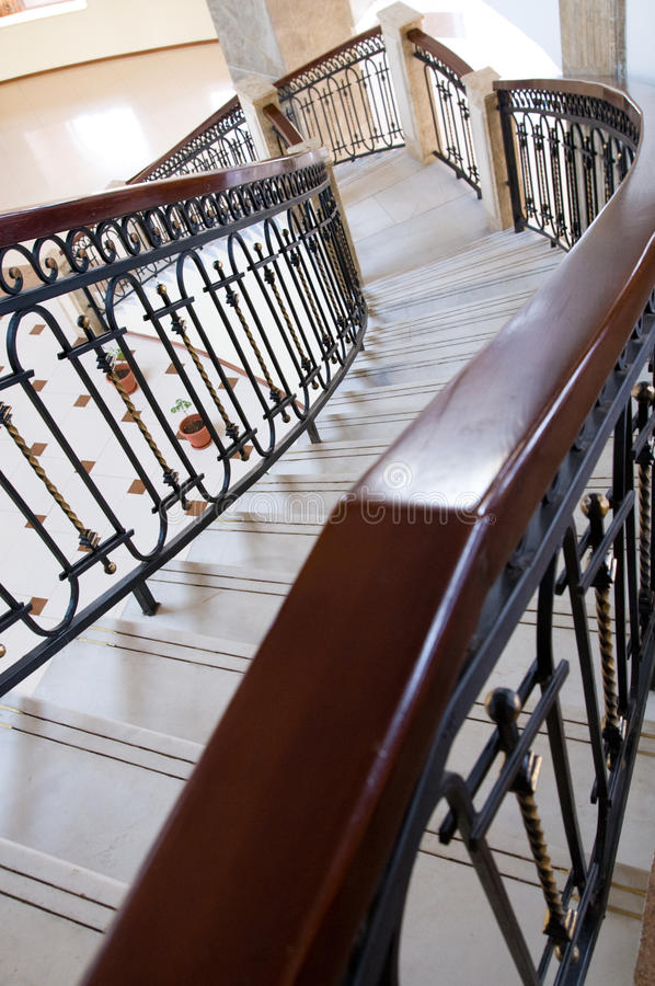Winding staircase with forged rail stock photos
