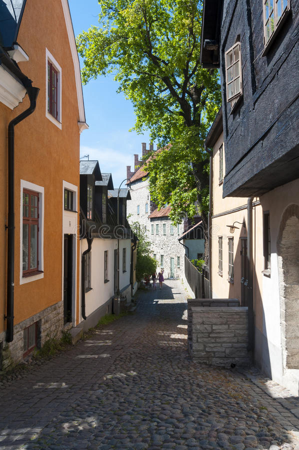 Winding street Visby. Winding street with paving stones in the medieval city of Visby. The hanseatic city of Visby is listed as a UNESCO World Heritage site royalty free stock image