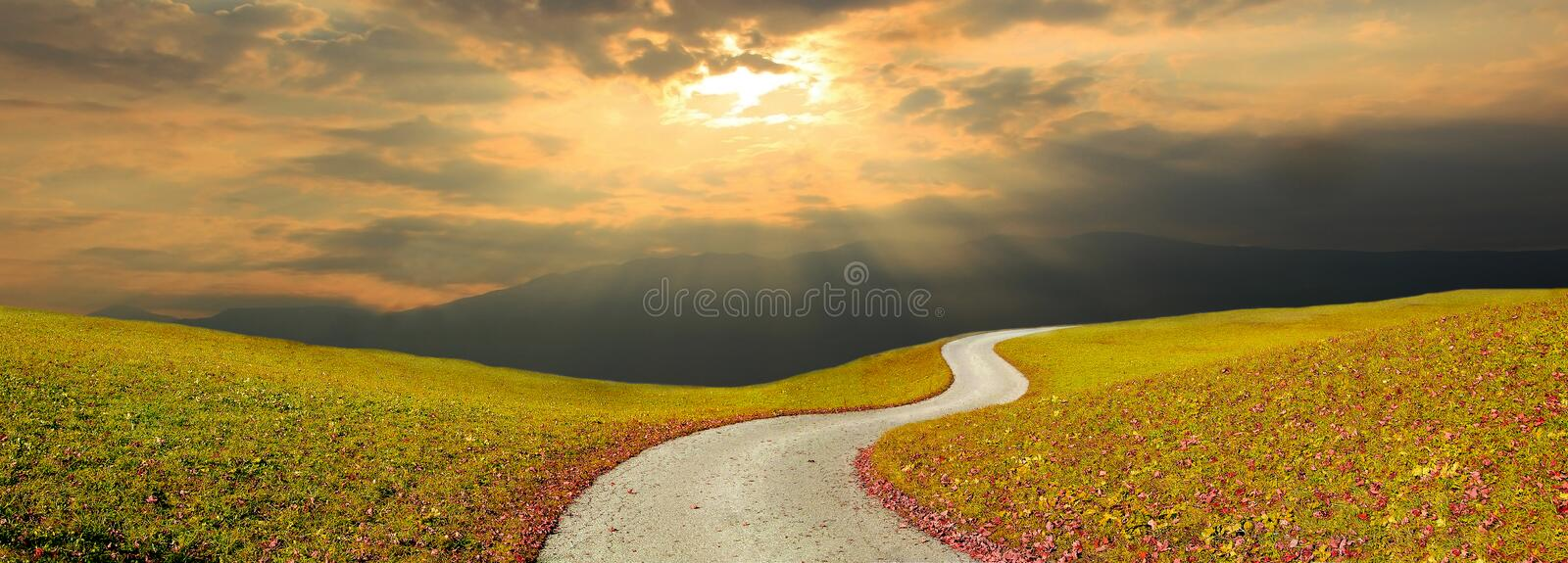 Winding way and sunset sky royalty free stock photo