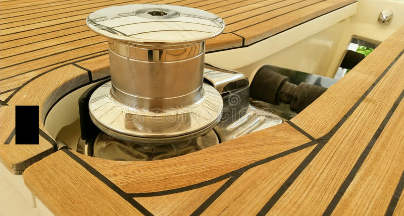 Windlass and teak deck background stock images
