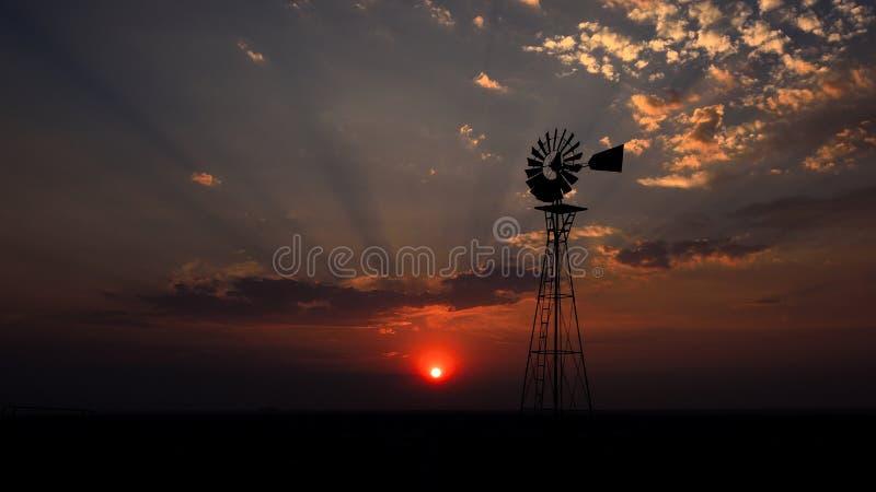Windmühle mit Sonneeinstellung hinter Frankreich lizenzfreie stockfotografie