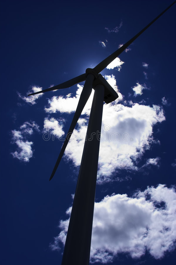 Windmill. Silohuette of a windmill for generating electricity royalty free stock photo