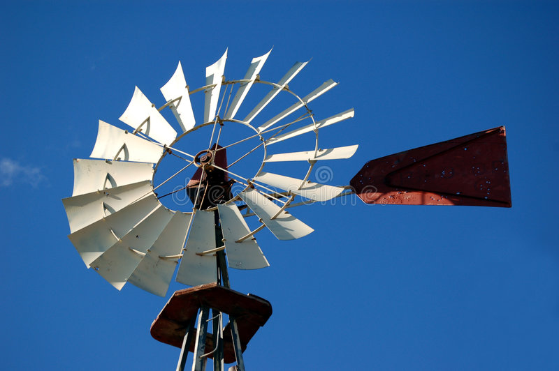 Windmill Against Blue Sky. Old windmill framed against the southwest blue sky stock photography