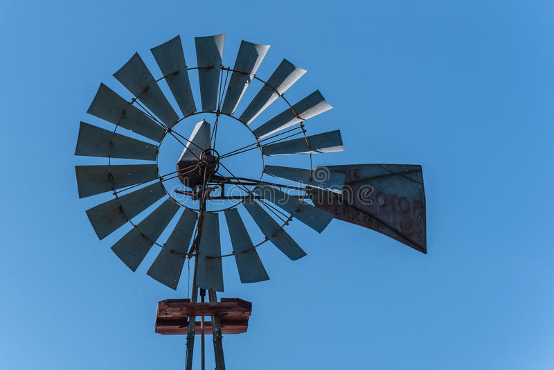 Windmill Against a Blue Sky. On a sunny day. Isolated stock photo
