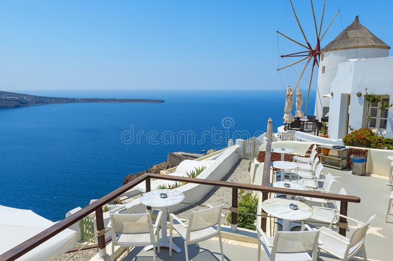 Windmill And Beautiful View In Santorini. Beautiful View With A Windmill in Oia, Santorini, Greece stock photography