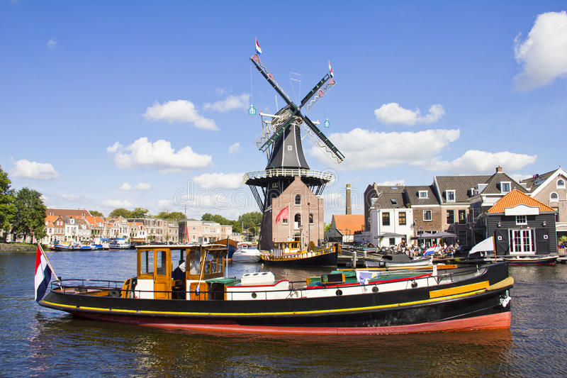 Windmill and boat, Haarlem, Holland stock photo