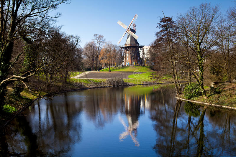 Windmill in Bremen. Windmill and it's reflection in lake in Bremen, Germany stock photos