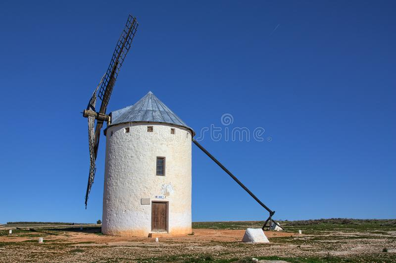 Windmill - Campo de Criptana Spain. Old typical windmill located in Campo de Criptana, Spain, very well conserved. It`s not in use but it seems to be ready to royalty free stock photography