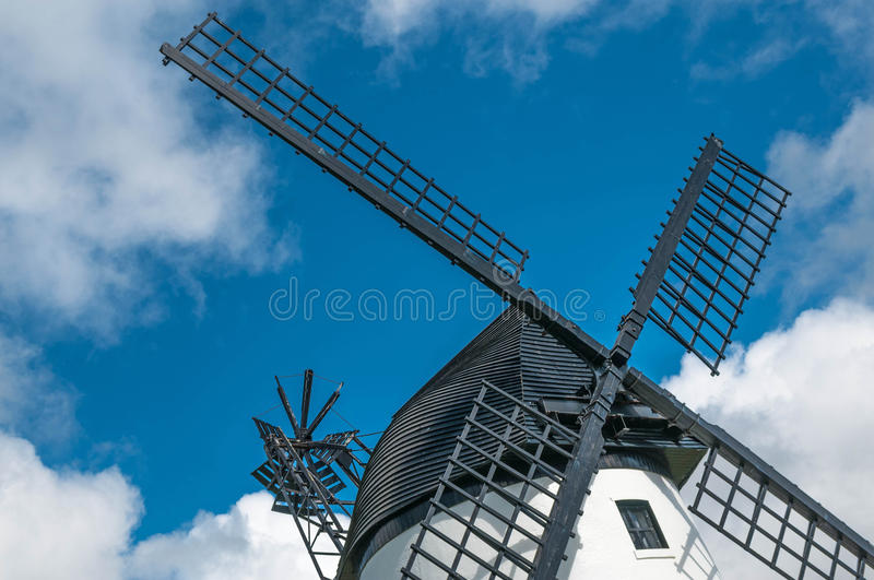 Windmill close up, with black sails and blue sky royalty free stock photo