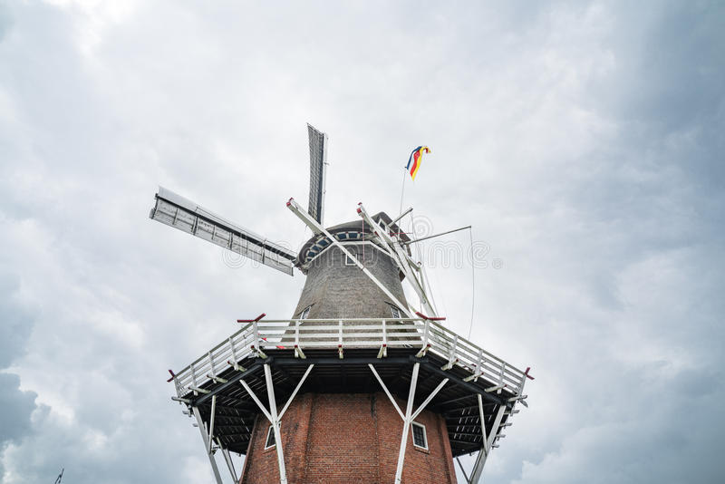 Windmill and cloudy skys in Dokkum - Netherlands. Upward shot of a windmill with cloudy skys in northern region of Netherlands. Dokkum, Netherlands royalty free stock photo