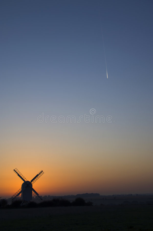 Download Windmill with con trail stock photo. Image of britain - 1500770