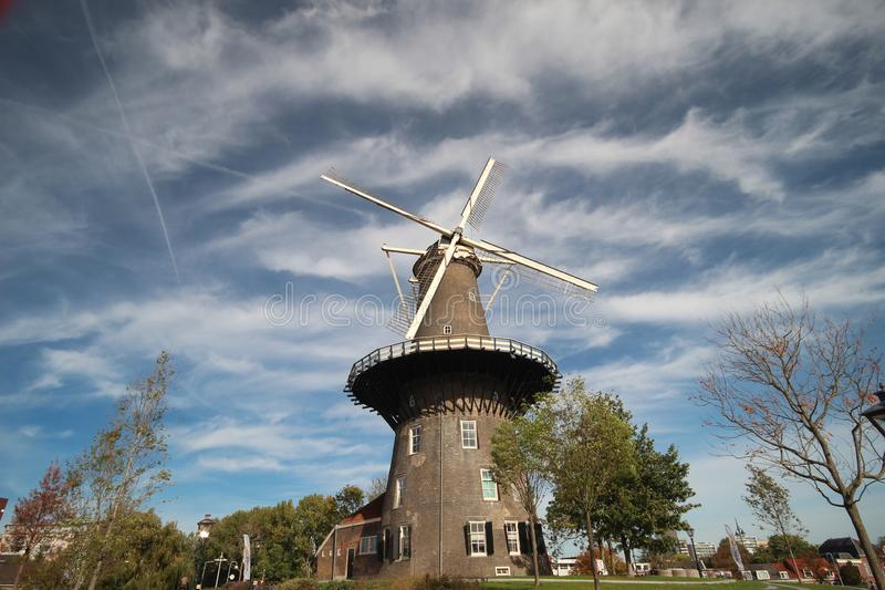 Windmill De Valk in the inner city of Leiden in the Netherlands, windmill have a museum in it and is part of the water works. Windmill De Valk in the inner city stock photos