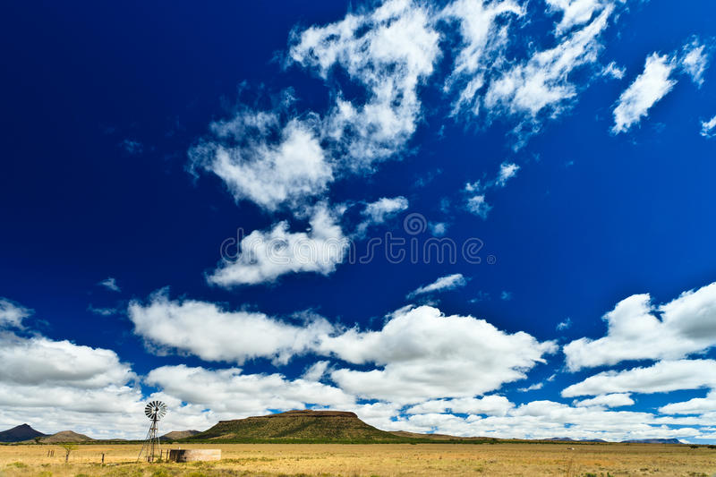 Download Windmill In A Desolate Landscape Stock Photo - Image: 24327784