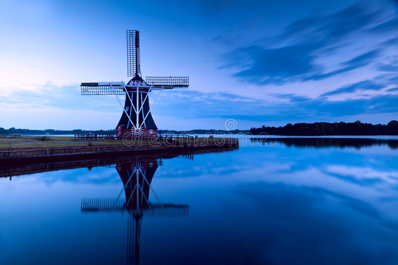 Download Windmill in dusk stock image. Image of reflect, wooden - 25648161