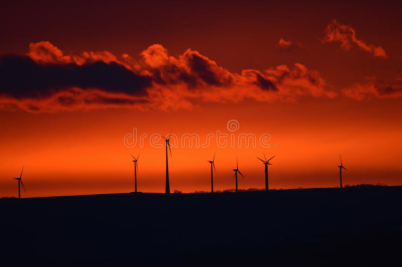 Windmill at early sunrise royalty free stock photography