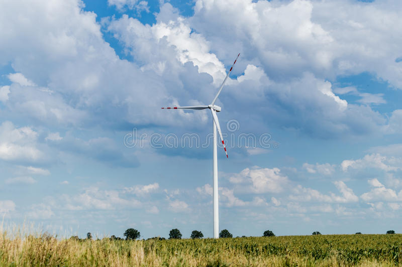 Windmill for electric power production in country side background, Poland.  royalty free stock image