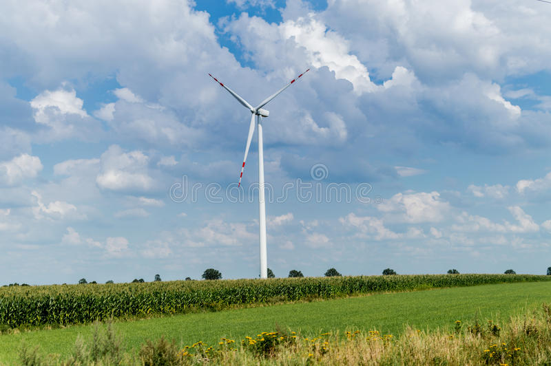 Windmill for electric power production in country side background, Poland.  royalty free stock photography