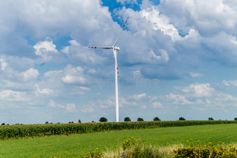 Windmill for electric power production in country side background, Poland.  stock photo
