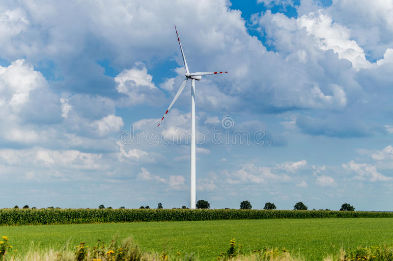 Windmill for electric power production in country side background, Poland.  royalty free stock images