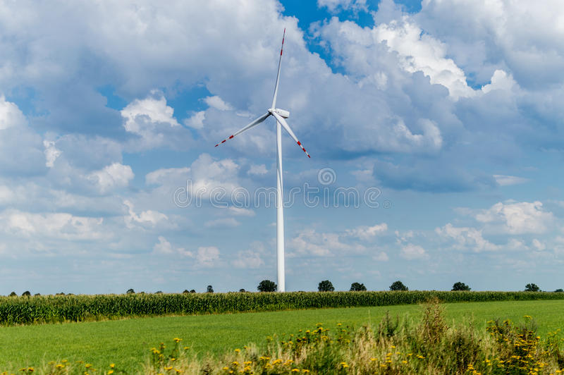 Windmill for electric power production in country side background, Poland.  stock photography