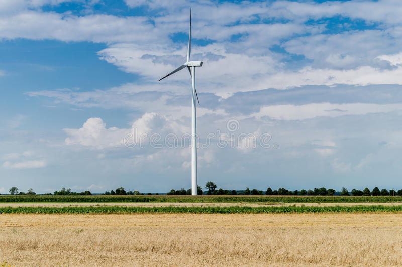 Windmill for electric power production in country side background, Poland.  royalty free stock photos