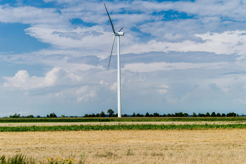 Windmill for electric power production in country side background, Poland.  stock images