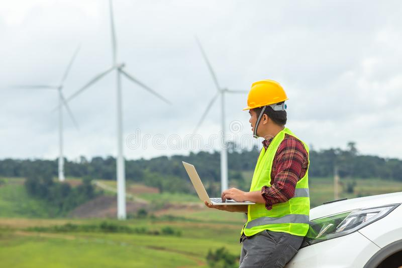 Windmill engineer inspection and progress check wind turbine at construction site By using a car as a vehicle stock images
