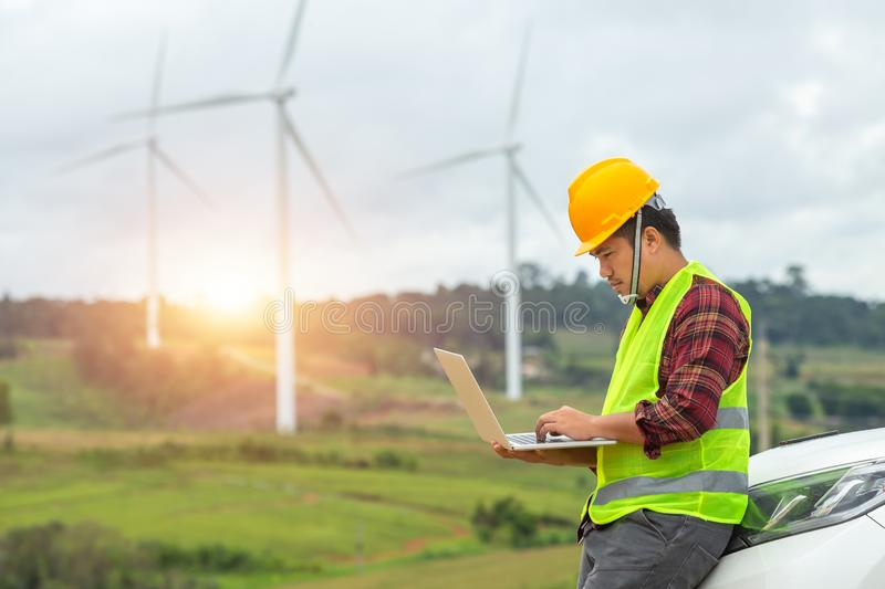 Windmill engineer inspection and progress check wind turbine at construction site By using a car as a vehicle stock photo