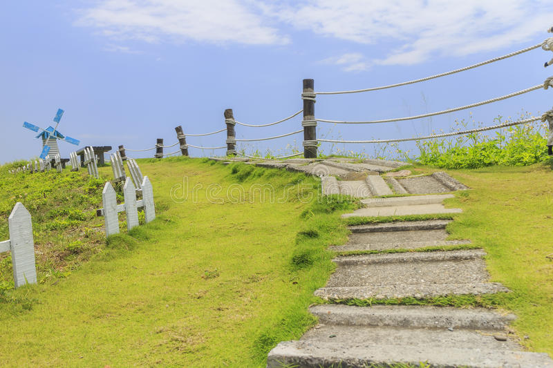 Windmill, fence and path in Taitung, Taiwan stock photo