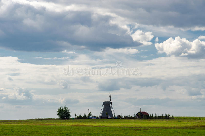 Windmill on the field. Belarus, Minsk region, Dudutki. Windmill on the field royalty free stock image