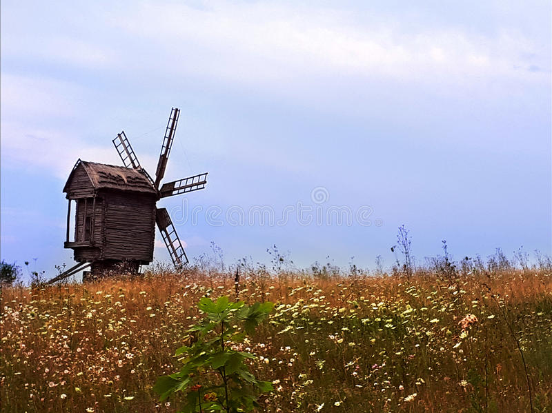 Windmill in the field stock image