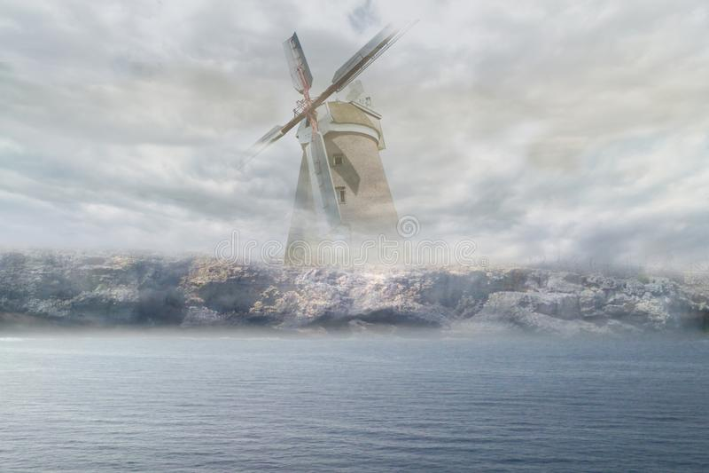 Windmill in the fog stock image