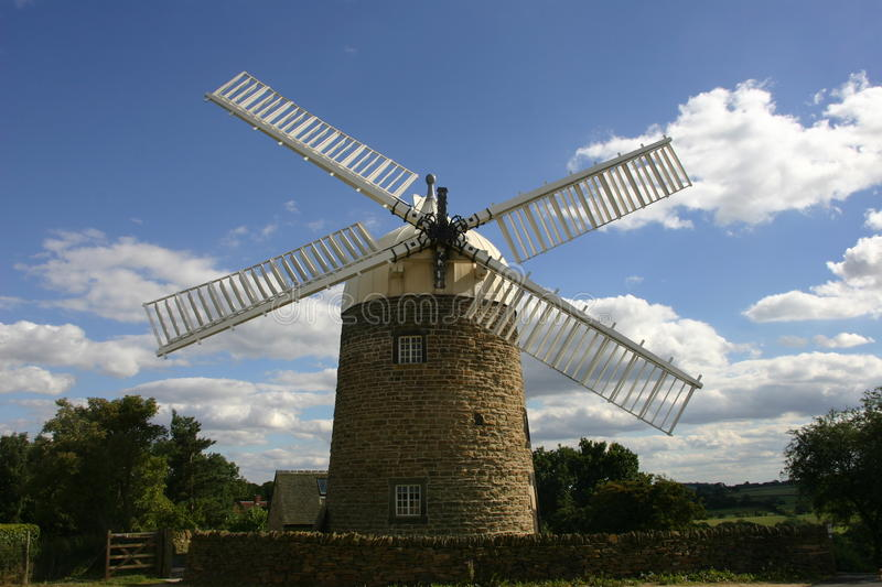Heage windmill, Derbyshire. Heage windmill in Derbyshire from the front showing the cap and four out of the six sails (two missing) with a background royalty free stock image