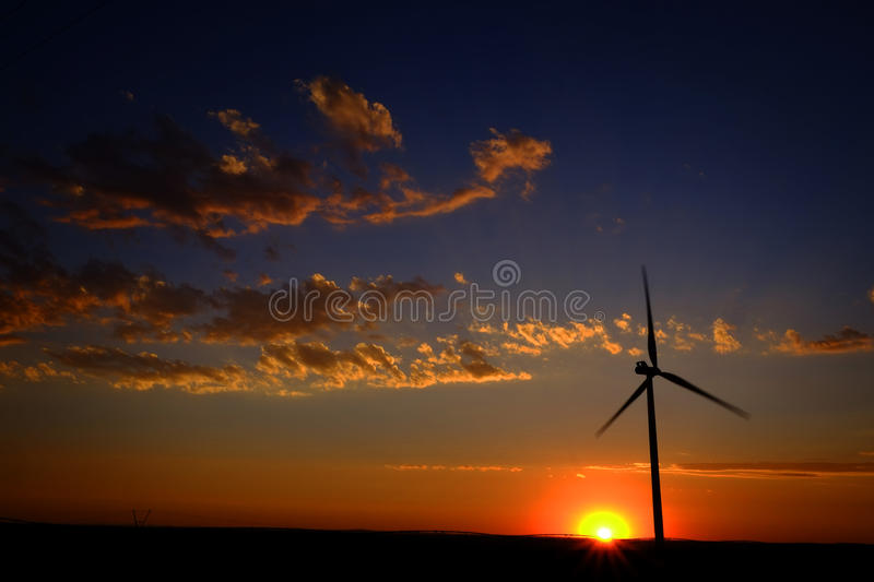 Windmill for Generating Power Wind Blowing Sky Clouds Sunset Sun royalty free stock photos