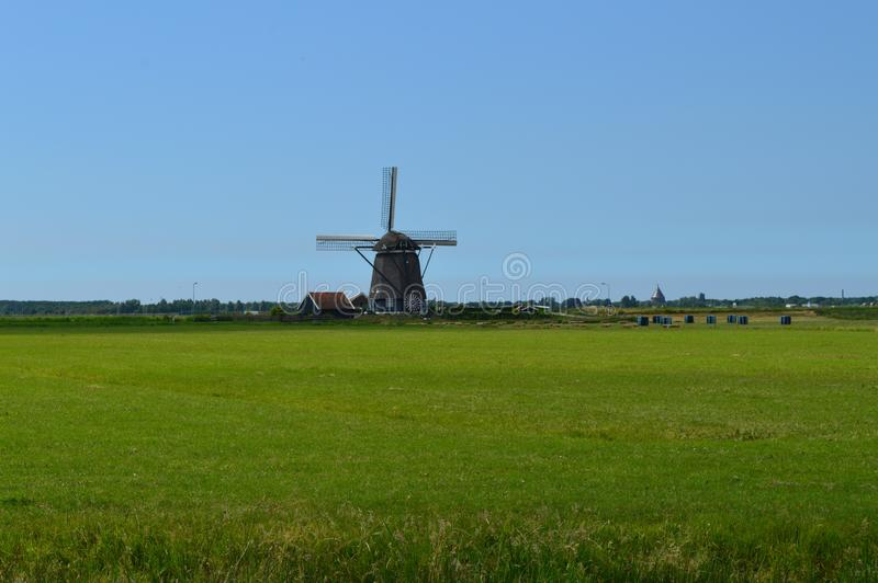 Windmill, Grassland, Field, Sky royalty free stock photo